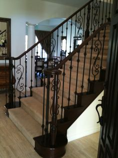 Charming Wrought Iron Balusters For Elegant Interior Staircase Design: Appealing Dark Wrought Iron Balusters With Cozy Stair Carpet And Cozy Parkay Floor