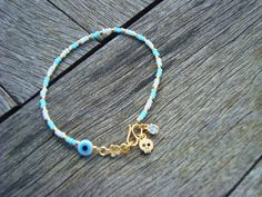 Evil Eye Beaded Tiny Gold Skull Friendship Bracelet  by cocolocca, $11.00