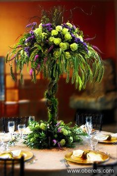 Mardi Gras Centerpiece - can't afford quite this with the flowers but just beautiful, colors and style!