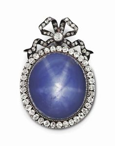 a_silver_topped_gold-mounted_star_sapphire_and_diamond_pendant_brooch_d6004288g.jpg (808×1024)