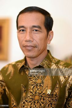 Joko Widodo, Indonesia's president, poses for a photograph in his office at Istana Merdeka, the president's official residence, in Jakarta, Indonesia, on Monday, Feb. 2, 2015. Widodo will decide this week whether to install as police chief a three-star general who faces a corruption probe, as he seeks to end an episode that put his graft-fighting credentials in question. Photographer: Dimas Ardian/Bloomberg via Getty Images