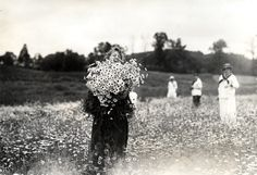 "cemeterywind:  ""Circa 1910s, a cheerful group of Vassar College students gather daisies for the annual daisy chain ceremony, a tradition that has endured at the college for over 120 years.  """