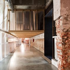 Office for Strategic Spaces has used low-budget materials to transform an industrial building in Madrid into a multi-level workspace for creative businesses