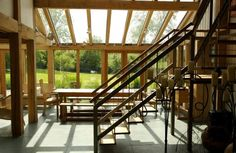 Oak dining table and bench seating in glazed oak dining / conservatory