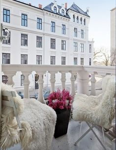 layered sheepskins on simple metal folding chairs-so chic: ZsaZsa Bellagio: House Beautiful