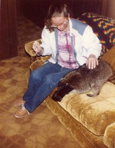 Cyndi with Retta and Buck's friendly Racoon