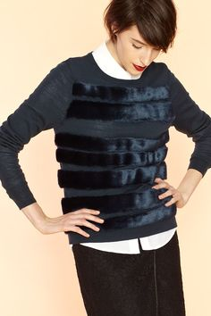 Let Tibi take the luxury up a notch with their Faux Fur-Striped Wool Sweater.