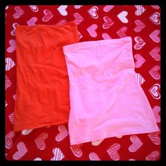 TUBE TOP BUNDLE Basic tube tops one orange and the other bright light pink. Both have light liners inside but no padding. Very cute. Both size SMALL. The orange is 95% cotton and 5% spandex. The pink is 57% cotton 38% polyester 5% spandex. The orange is CITY STREETS and the pink is NO BOUNDARIES. Tops