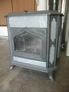 Wood-Stove-Woodstock-Soapstone-Co-Fireview-Model-with-Flue-Piping-and-Shields  Wow!!! It's not tulikivi but it's still beautiful Wood Stoves, Soapstone, Woodstock, Great Rooms, New Homes, House Ideas, Cabin, Model, Life