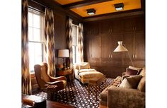 Cozy den in a Lower 5th Ave. townhouse by designer Steven Gambrel