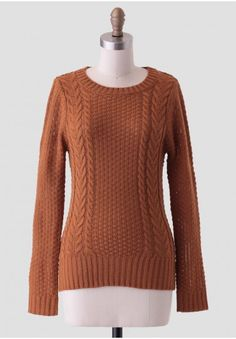 <p>Get cozy with this vibrant camel-colored sweater featuring an allover waffle knit design with contrasting cable-knit detailing at the front. Finished with thick ribbed hems, this rustic sweater can be worn layered over a fit-and-flare dress for added warmth and texture. Unlined, opaque.</p><p>100% Acrylic<br /> Imported<br /> 30
