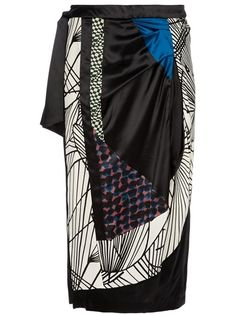 Black silk skirt from Dries Van Noten featuring a patchwork print design in white, cobalt blue and green, a draped detail at the front and a ribbon fastening at the side.