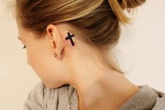 cross ear tattoo