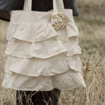 Wonderful ruffle Tote bag, site also has awesome messenger bags, camera bags, etc