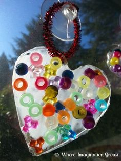 Easy heart suncatchers for toddlers and preschoolers using glue and beads. A simple Valentine's Day craft for kids!