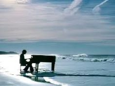 Piano on a beach.