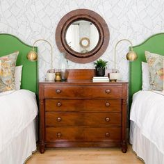 green headboards and a cool chest of drawers.
