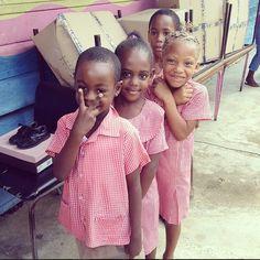 Beautiful little girls at a school in Jamaica.   Travel4Souls / Soles4Souls shoe distribution. June 2013.