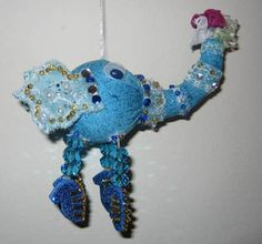 """Dancing is a Fantastic Way to Get Joy & Excitement!""- Steve Mueller Blue Elephant Is ready for a dancing party. His whole body is sparkling with beads and glitters. Let him go!"