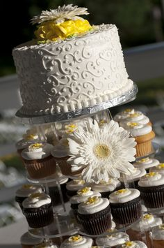 I like the scroll, not the daisy. Cupcakes are simple.