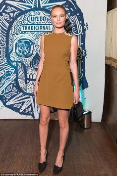 Skinny Minnie: Meanwhile, Bosworth opted for a moss-shaded, sleeveless Self-Portrait mini-dress with a black Eddie Borgo purse and matching court shoes - November 1, 2016