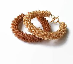 Chunky bracelet wire crocheted in two color options for you to choose- gold or bronze.  The bracelets are 17 cm long and close with toggle clasps.   You can request custom ... #handmade #jewelry #boho #etsy #epiconetsy #shopping #shopsmall #jewelryonetsy #etsyseller #crochet
