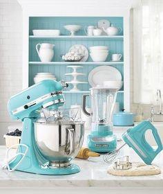 Range of blue KitchenAid appliances in lovely blue and white kitchen