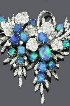 Stunning black opal and diamond necklace.