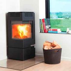 Aduro 12 Stove - The Aduro 12 is a cube style wood-burning stove with large corner glass to provide stylish view of the flames from several angles. This stove is the ideal corner solution, since the flue outlet can be angled to both sides.
