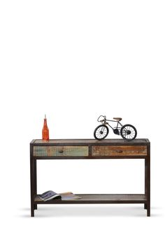 Our rustic industrial console table in your front room will present a vintage look with style. The drawers of the Owen Industrial 2 Drawers Console Table are the focal point of this classic display of natural wood and black Owen iron. The console table provides a warm welcome into any home.     Note: Each piece will have its own unique imperfections and markings. These features are not defects and should be appreciated as they make each piece rare and unique.