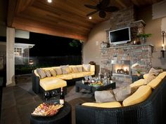 Create a cozy living room space outside complete with fireplace and an entertainment center.  www.ephenry.com