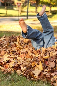 Autumn...playing in piles of leaves...so much fun! You never see kids outside playing like this anymore... so sad  :(