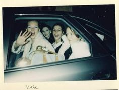 KM squashes into a car full of friends on a night out.