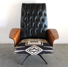 """A fantastic collectible Mid Century piece, professionally restored from the bottom up and in exceptional cosmetic and structural condition.A truly one of a kind piece.  Designed by George Mulhauser and manufactured by Plycraft.  Tufted, high back is supportive and comfortable.  Gleaming, sculptural walnut """"wing"""" arms are unique to the design.  Seat is upholstered in a Pendleton Navajo print that is soft, blanket-weight wool.  Rocking/reclining mechanism makes this ..."""