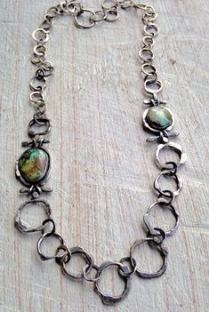 Julianne Van Buskirk Hand-forged Sterling links flank Nevada Turquoise.