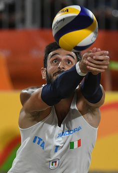 Italy's Paolo Nicolai controls the ball during the men's beach volleyball…