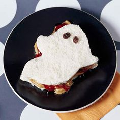 Haunting PB& J from Parents.  Ghost shaped peanut butter & jelly sandwich.  Use a ghost-shaped cookie cutter & add raisins for eyes.