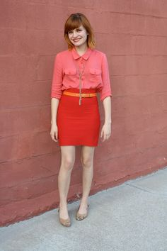 red skirt pink shirt orange belt nude flats