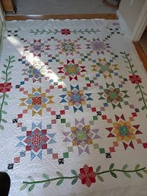 lovely example of using blocks of different colours, to combine in a cohesive quilt