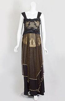 Edwardian beaded dress | 1916 | The layered styles of the period intimate a beguiling feminine mystique | In this exemplar of the style, lace appliqués on the bodice peek through an outer layer of beaded tulle | The enigmatic zigzag motif on the bodice hints at an arcane, portentous mystery.