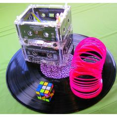 party decorations centerpieces made from cassette tapes, record, slinky, and rubiks cube Retro Party, Neon Party, Disco Party, 90s Party Decorations, Party Themes, Party Ideas, Table Decorations, 80s Birthday Parties, 40th Birthday