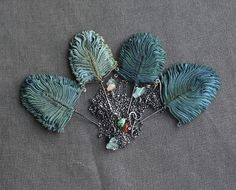 feather fan, don't know what these are made of, but they are gorgeous!