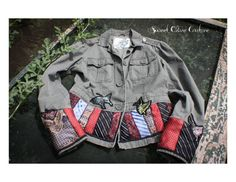 https://www.etsy.com/listing/202650824/tie-jacket-junior-m-butterfly-on-etsy?ref=related-2   unior M, fitted, button down jacket. butterfly appliques, necktie trim on bottom hem of jacket and sleeves. One of a kind, unique piece. Made by Sweet Olive Couture