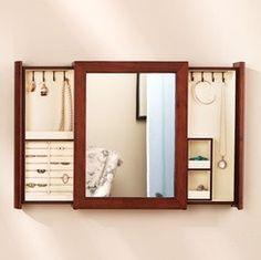 Secret jewelry drawers behind mirror.