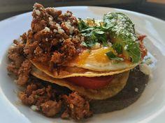 Brunch menu: Huevos Rancheros- Two eggs to order, crispy corn tortillas, Ranchero sauce, spicy black bean puree, avocado, Queso Fresco.