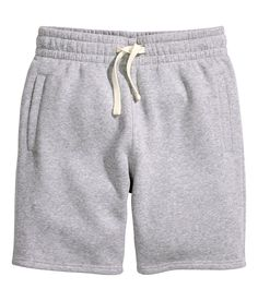 Knee-length shorts in sweatshirt fabric with elasticized drawstring waistband.   H&M Divided Guys