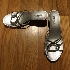 """Kenneth Cole Reaction sandals Kenneth Cole Reaction """"Chain Zone"""" silver strappy, wedge sandals. Leather upper. Synthetic lining. Man made sole. Heel height is approximately 2.5 inches. Few scrapes on the heels (pictured). Worn lightly. Kenneth Cole Reaction Shoes Wedges"""