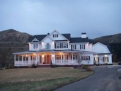 perfect country home...love this!!!! Edwin and I are huge fans of the wrap around porch...our dream home