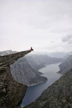 Trolltunga Rock - Odda, Norway You wouldn't catch me out there on the edge like that!!! Bt it is a beautiful sight to behold!!!