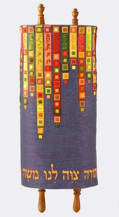 Torah Mantle by Adina Gatt, Efod Art Embroidery. Hand embroidery and applique. This Torah cover is decorated with the names of the books of the bible and color blocks.